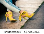 woman legs in leather yellow ... | Shutterstock . vector #667362268