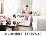 happy indian father playing... | Shutterstock . vector #667364164