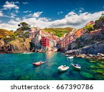 First city of the Cique Terre sequence of hill cities - Riomaggiore. Colorful morning view of Liguria, Italy, Europe. Great spring seascape of Mediterranean sea. Traveling concept background. - stock photo
