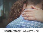 woman holding man around neck... | Shutterstock . vector #667395370
