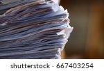 stack of paperwork on working...   Shutterstock . vector #667403254