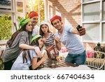 group of friends enjoy... | Shutterstock . vector #667404634