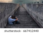 young asia boy alone and scared | Shutterstock . vector #667412440