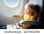 adorable little girl traveling... | Shutterstock . vector #667442338