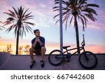 handsome hipster texting while... | Shutterstock . vector #667442608