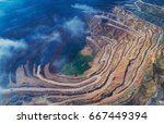 aerial view of opencast mining... | Shutterstock . vector #667449394