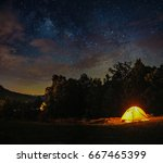 a camping tent under milky way... | Shutterstock . vector #667465399