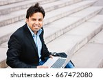 indian businessman sitting on... | Shutterstock . vector #667472080