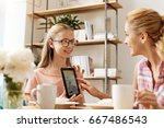 caring daughter showing a... | Shutterstock . vector #667486543