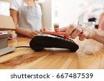 neat female hands paying a bill ... | Shutterstock . vector #667487539