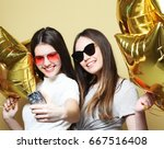 two teenage girls friends with... | Shutterstock . vector #667516408
