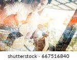 businessman holding a little... | Shutterstock . vector #667516840