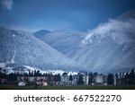 small town at the bottom of the ... | Shutterstock . vector #667522270
