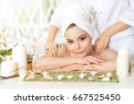 girl lying down on a massage bed | Shutterstock . vector #667525450