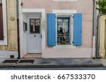 pink french house with blue... | Shutterstock . vector #667533370
