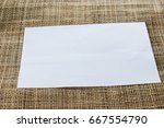 white paper on a grid pattern | Shutterstock . vector #667554790
