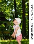 baby girl on park. | Shutterstock . vector #667604656