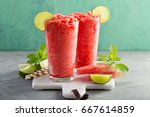 watermelon slushie with lime ... | Shutterstock . vector #667614859