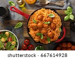 spaghetti with tomato sauce and ... | Shutterstock . vector #667614928