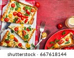 deliciously simple tomato tart... | Shutterstock . vector #667618144