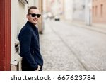 confident fashionable man... | Shutterstock . vector #667623784