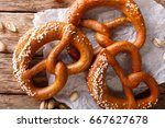 freshly baked soft pretzel with ... | Shutterstock . vector #667627678