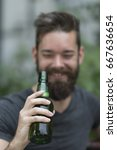 handsome hipster guy holding a... | Shutterstock . vector #667636654