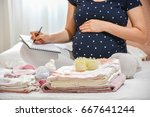 pregnant woman is packing baby... | Shutterstock . vector #667641244