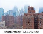 manhattan skyscrapers in fog | Shutterstock . vector #667642720