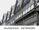 tudor buildings on an overcast... | Shutterstock . vector #667646260