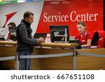 Small photo of VIENNA, AUSTRIA - APRIL 6, 2017. Service center at the Vienna airport Schwechat, Austria. An employee helps a passenger to obtain the necessary information.