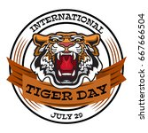 international tiger day emblem... | Shutterstock .eps vector #667666504
