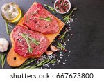 raw beef steak with spice | Shutterstock . vector #667673800