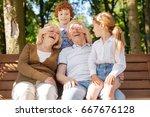 happy grandparents spending... | Shutterstock . vector #667676128