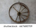 Old Wooden Wagon Wheel Hanging...