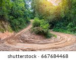 rain forest with a dirt road | Shutterstock . vector #667684468