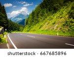road in austrian alps | Shutterstock . vector #667685896