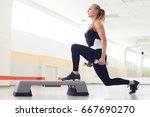 young woman holding dumbbells... | Shutterstock . vector #667690270