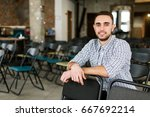 happy young freelancer in the... | Shutterstock . vector #667692214