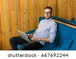 man with glasses working on... | Shutterstock . vector #667692244