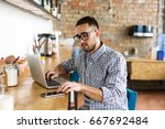 man working on laptop and using ... | Shutterstock . vector #667692484