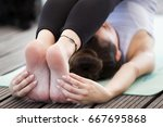 woman doing a yoga pose called... | Shutterstock . vector #667695868