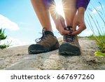 hiking shoes   woman tying shoe ... | Shutterstock . vector #667697260