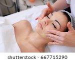 beautiful young woman getting a ... | Shutterstock . vector #667715290