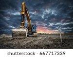 excavator machinery at... | Shutterstock . vector #667717339