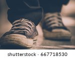 selective focus old sneakers... | Shutterstock . vector #667718530