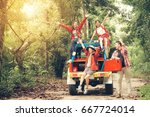 happy asian young travellers... | Shutterstock . vector #667724014
