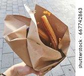spanish churros | Shutterstock . vector #667742863