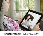 mature woman looks at tablet... | Shutterstock . vector #667762324