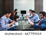 group of asian business people... | Shutterstock . vector #667795414